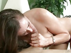 Sexy mature brunette knows how to treat ...