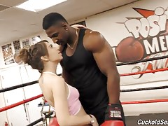 The first thing she noticed was her instructor, an incredibly masculine, well-built black Bull. Joseline`s pussy began to tingle when they first met, and now The Bull has Hubby in the ring, using him to demonstrate how to punch a would-be attacker effecti