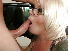 Big boobed mature blonde hungrily slurps friend`s dong.