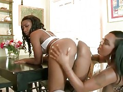 Two lovely ebony lesbians are having sex fun in kitchen.